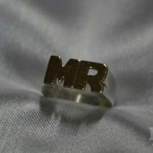 Anillo iniciales plata y oro